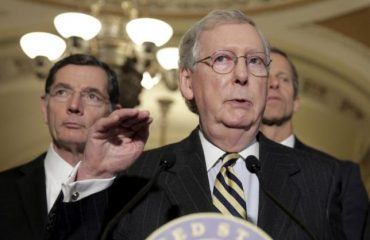 Senate Majority Leader Mitch McConnell (R-KY) speaks during a news conference as Senator John Barrasso (R-WY) listens on Capitol Hill in Washington March 8, 2016.      REUTERS/Joshua Roberts